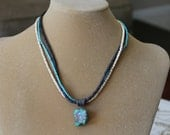Single Turquoise Nugget Suspended from a Sterling Silver Bail and Triple Strand of Shell and Bone Beads, Southwestern Style Necklace, Gift