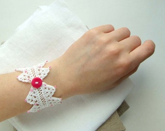 White knitting lace wrist cuff bracelet with seed beads and button pink color
