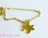 Gold puzzle piece charm necklace