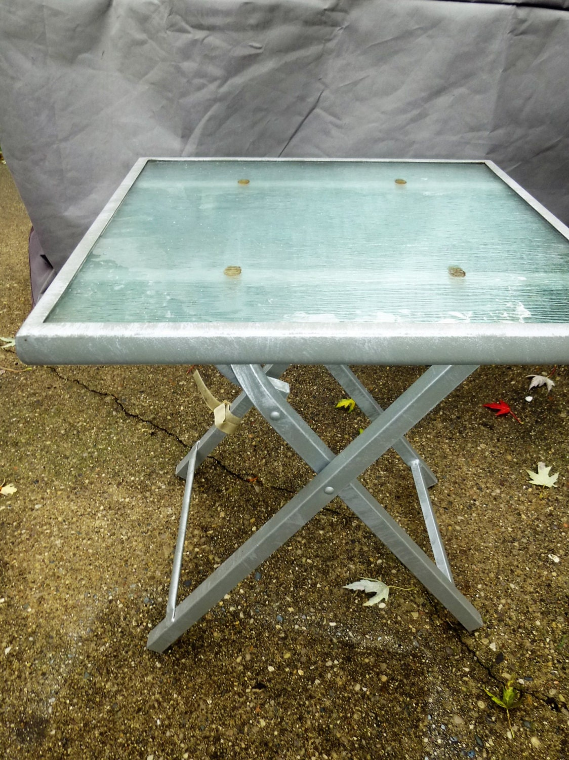 Funky folding tempered glass and cast aluminum side or end table ...