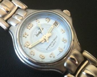 Vintage Women's watch, Vanity Fair, Silver Color Case, Round Bezel, Pale Blue Tone Dial, Date Window, 3ATM,