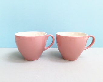 Pair of pastel pink teacups, made in England