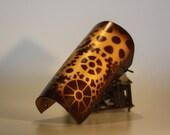 steampunk leather bracer , golden cog gears