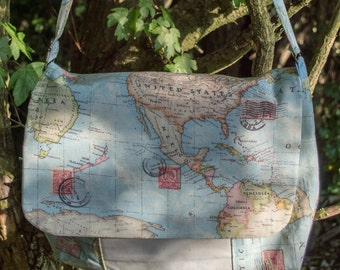 World Map Messenger Bag with front and inside pockets and adjustable strap