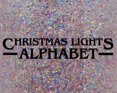 "Christmas Lights Alphabet iridescent and holographic glitter nail polish 15 mL (.5 oz) from the ""Curiosity Door"" Collection"