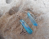 Blue irradiated crystals with a triuquera earrings
