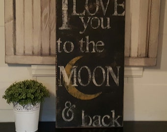 Distressed and vintage look I love you to the moon and back sign/wall decor