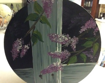 Round wooden box with lilacs painted on top