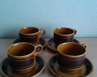 Set of four 1970's Honey and Mustard tea cup and saucer set Kiln Craft