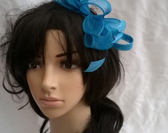 Turquoise  Feather Fascinator..on a comb .. Stunning Sinamay and  Feather with Leaves,loops &  Feathers