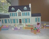 My Pretty Dollhouse by Galoob. Complete house with garage, dolls and furniture