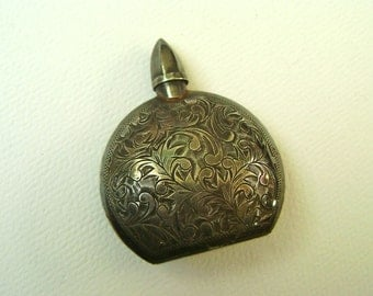 antique silver perfume bottle, so ornate