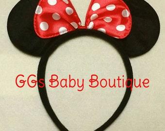 Minnie Mouse headband ears with bow.