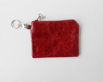 Red leather coin purse, or key ring.  Would make a good gift card holder.