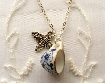 Blue and white china teacup necklace with little silver bee