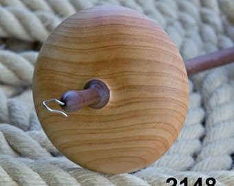A hand made top whorl drop spindle