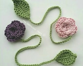 A pair of handmade crocheted floral bookmarks