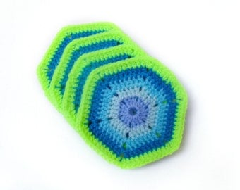 4 handmade blue and lime green hexagonal coasters