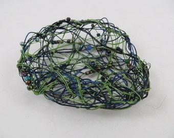 Baskets, wire baskets, woven baskets, random weave, weaving, wire, blue, green