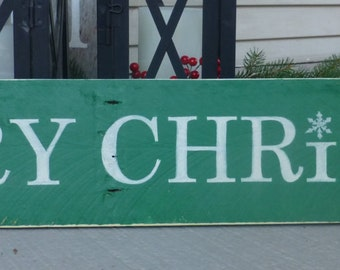 Very rustic hand painted Merry Christmas sign