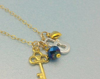 Gold Key Necklace. Gold Vermeil key necklace with gold vermeil heart, sterling lock and semi-precious birthstone dangle. The Key To My Heart