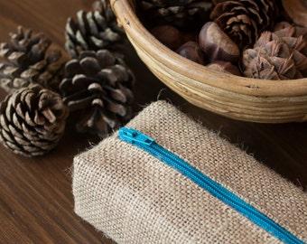 Natural burlap pencil case with bright blue zip closure
