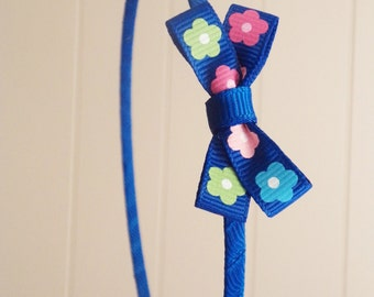 Blue pink and green bow metal headband