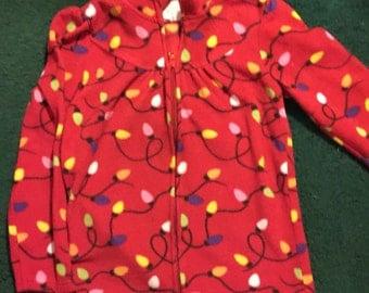 Cute fleece style zip jacket with Chrismas Lights.  Girls sized Medium (7/8)