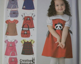 Simplicity 3662 Toddlers (Size A 1/2, 1, 2,3, 4) jumper, blouse and tote bag