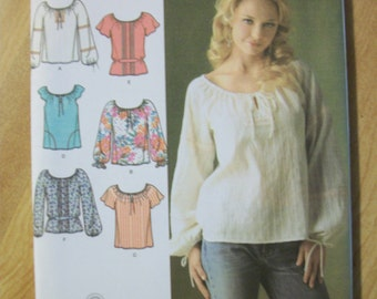 Simplicity 4177 (Misses K5 8,10,12,14,16) top with sleeve and trim variations.  6 Made Easy!