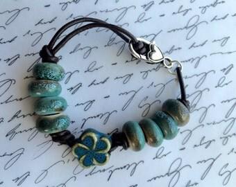 "8"" leather and ceramic bracelet."
