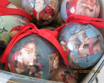 Vintage set of 12 Around the World Santa Claus  Decoupaged ball ornaments used