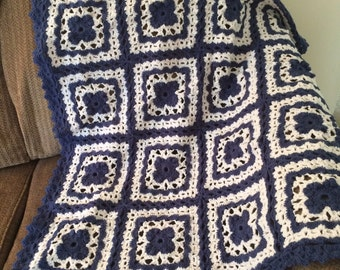 Lacy granny squares afghan