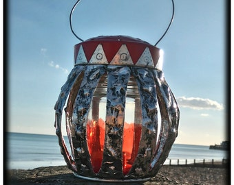 Coffee Tin Lantern with red glass made from a coffee tin.