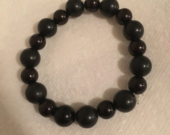 Black plastic pearl bracelet