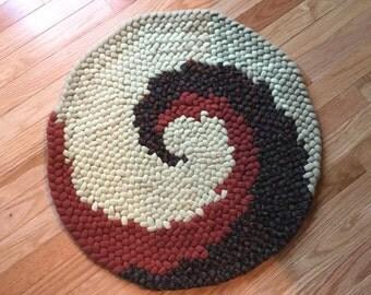 Light green, rust and multi pinwheel rug