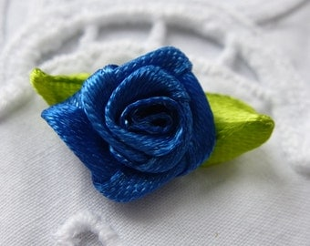 Blue satin roses.   Approximately 16mm wide and 25mm across.  Set of 20