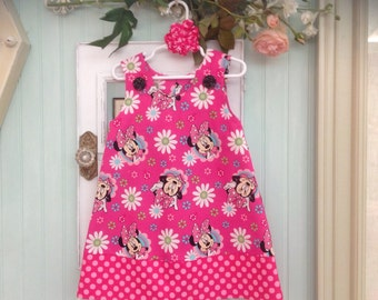 Pink Minnie Mouse Disney Dress with coordinating Pink Dotted Band, (infant, baby, girl, toddler,child) with matching hair accessory.