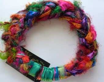 Colorful Fuzzies Sari Silk Braided Headband is naturally wild! Untamed strands of upcycled sari silk are woven into my unique hair accessory