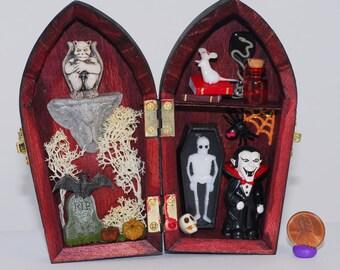 Miniature gothic coffin with gargoyle and vampire theme halloween