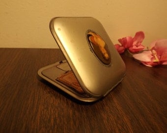 Compact, c 1920s.Antique compact.Accessories. Metal compact with lady's portrait.Vanity item.Gift to collector.Accessories.Compact mirror.