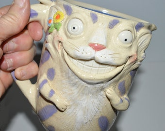 Cheshire Cat Pitcher - tail on backside. Handsculpted stoneware signed J Cotton One of a kind-16 oz