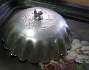 Fluted aluminum dome with rose design