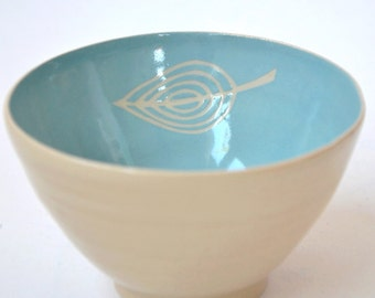 Bowl in turquoise blue with papercut leave