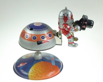 Astronaut with Space Station and Camera Clockwork Old Tin Toy