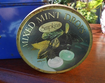 round metal tin collectible storage canister kitchen decor mint drops advert logo vintage decorative sweet jar