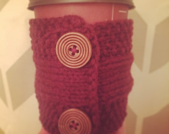 handmade knitted coffee cozy with dark wooden buttons (in maroon)