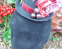 Burgundy and purple mini top hat with berries