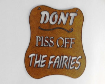 Don't Piss off the Fairies sign made out of rusted metal