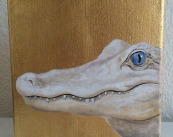 Albino alligator on gold leaf